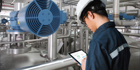 Engineer with data tablet