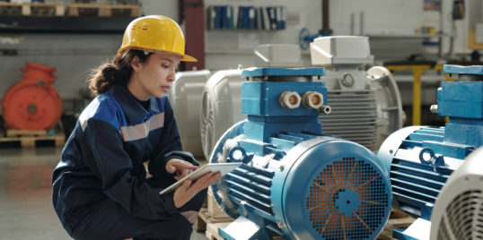 Young serious female engineer in protective helmet 4 WNQM6 D
